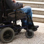 View of a person's legs in a wheelchair